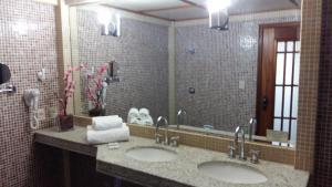 Um banheiro em Hotel Sagres