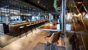 A restaurant or other place to eat at Van der Valk Hotel Leeuwarden