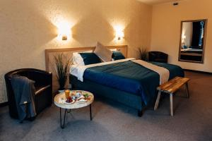 Кровать или кровати в номере Загородный отель forRestMix club