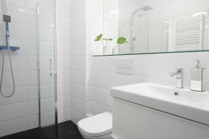 A bathroom at Mint Apartment
