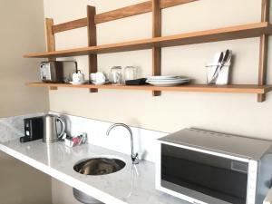 A kitchen or kitchenette at AQ Tailored Suites