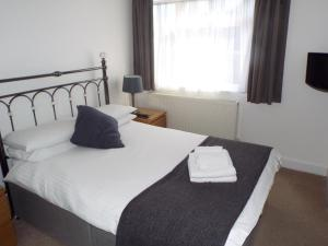 A bed or beds in a room at The Westby