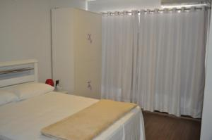 A bed or beds in a room at Casa de Flor