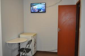A television and/or entertainment center at Casa de Flor