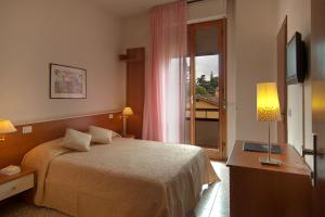 A bed or beds in a room at Diva Hotel