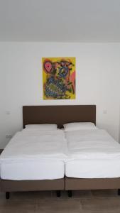 Ein Bett oder Betten in einem Zimmer der Unterkunft KM Hotel Murtal