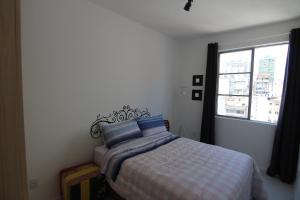 Cama ou camas em um quarto em Sweet Home Porto Alegre