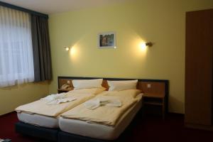 Ein Bett oder Betten in einem Zimmer der Unterkunft Radduscher Hafen