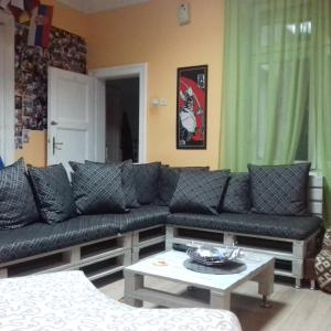 A seating area at Habitat Hostel