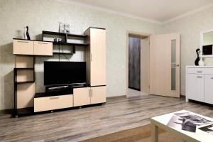 A television and/or entertainment center at PaulMarie Apartments on Yakubovskogo str.