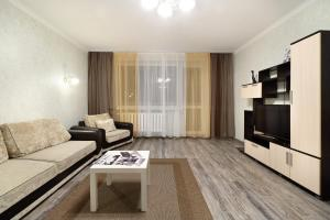 A seating area at PaulMarie Apartments on Yakubovskogo str.