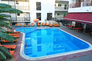The swimming pool at or near Poseidon Hotel and Apartments