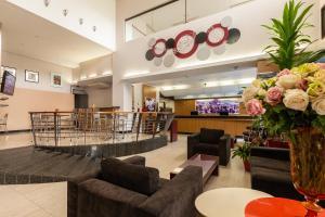 The lobby or reception area at Tri Hotel Executive Criciúma