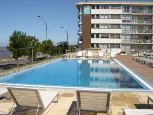The swimming pool at or near Real Colonia Hotel & Suites
