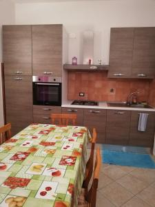 A kitchen or kitchenette at Apartment Su Passizzeri