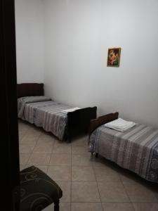 A bed or beds in a room at Apartment Su Passizzeri