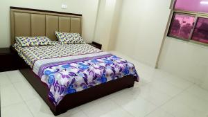 A bed or beds in a room at • Faizi Furnished Apartments