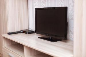 A television and/or entertainment centre at Великолепная квартира в Одинцово