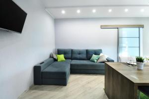 A seating area at PaulMarie Apartments on Yakubovskogo