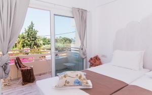 Ένα ή περισσότερα κρεβάτια σε δωμάτιο στο Stella Maria