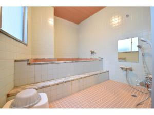 A bathroom at Hotel New Umeya