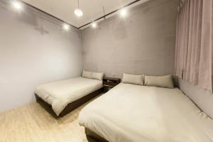 A bed or beds in a room at Slow Inn
