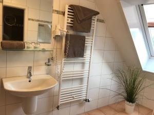 Ein Badezimmer in der Unterkunft Altstadtpension am Dom