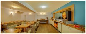 Een restaurant of ander eetgelegenheid bij Trip Inn Eden Antwerpen