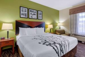 A bed or beds in a room at Sleep Inn & Suites Montgomery East I-85