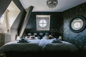 Een bed of bedden in een kamer bij Kasteel Pietersheim