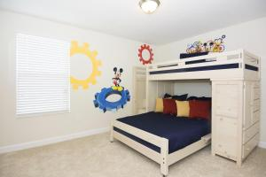 A bunk bed or bunk beds in a room at Dream Single Vacation Home Close to Disney SL4788
