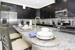 A kitchen or kitchenette at Dream Single Vacation Home Close to Disney SL4788
