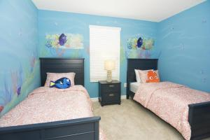 A bed or beds in a room at Dream Single Vacation Home Close to Disney SL4788