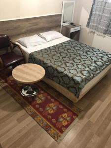 A bed or beds in a room at Hotel Kervansaray
