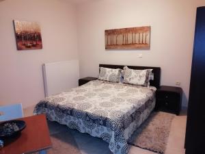 Ένα ή περισσότερα κρεβάτια σε δωμάτιο στο Toula Rooms
