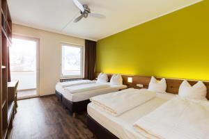 Ein Bett oder Betten in einem Zimmer der Unterkunft Basic Hotel Innsbruck