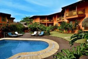 The swimming pool at or near Pousada Forte Rocha