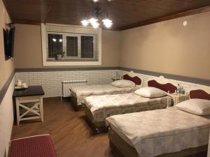 Кровать или кровати в номере Мотель Илевники