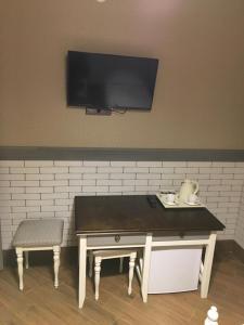 Телевизор и/или развлекательный центр в Мотель Илевники