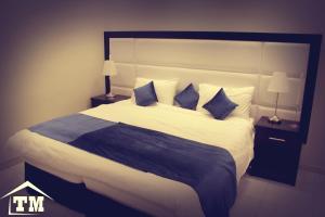 Cama ou camas em um quarto em شقق الزوايا الهادئه