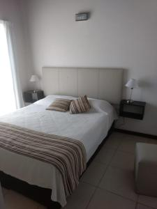 Una cama o camas en una habitación de Rincón del golf