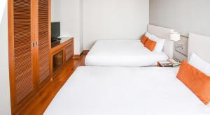 A bed or beds in a room at Hotel Prince Seoul