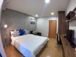 A bed or beds in a room at Tata House