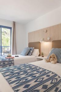 Un ou plusieurs lits dans un hébergement de l'établissement Aparthotel Pierre & Vacances Mallorca Cecilia