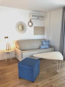 Coin salon dans l'établissement Aparthotel Pierre & Vacances Mallorca Cecilia