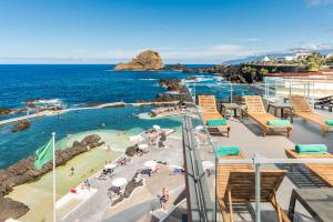 A view of the pool at Aqua Natura Madeira or nearby