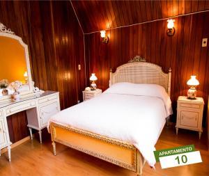 Cama ou camas em um quarto em Pousada Vale Verde