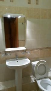 Ванная комната в Отельный Комплекс Югра