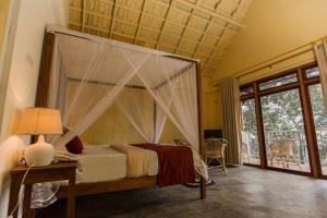 A bed or beds in a room at Serenite Ella