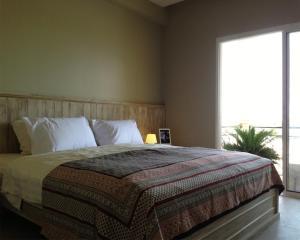 Ein Bett oder Betten in einem Zimmer der Unterkunft Swiss Palazzo